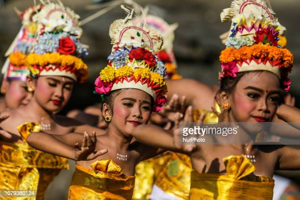 Balinese Hindu girls performs sacred Rejang Dewa dance during Ngebejian ritual as part of Pujawali ceremony at Tanah Lot temple in Tabanan Bali...
