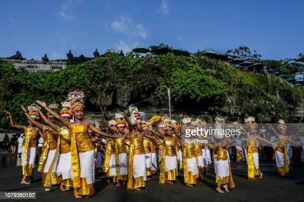 Balinese Hindu girls performs sacred Rejang Dewa dance during Ngebejian ritual as part of Pujawali ceremony at Tanah Lot temple in Tabanan, Bali,...