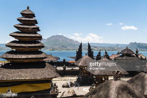 balinese hindu temple with mt batur in bali, indonesia - kintamani district stock pictures, royalty-free photos & images