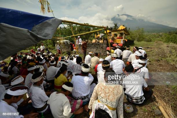 TOPSHOT Balinese Hindu villages attend a ceremony to pray for the Mount Agung volcano to stop erupting at a temple at Kubu subdistrict in Karangasem...