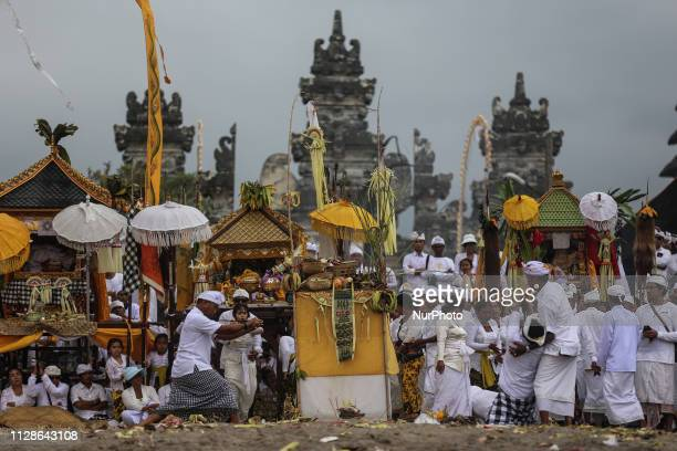 A Balinese Hindu worshiper attempts to stab himself with traditional Kris daggers while in trance during the Melasti ritual ceremony at Batu Bolong...
