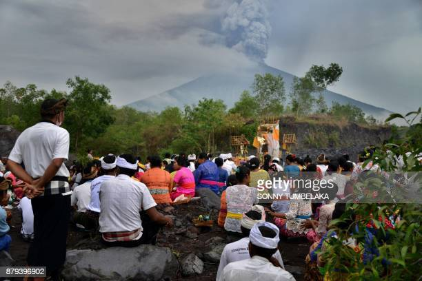 TOPSHOT Balinese Hindus take part in a ceremony where they pray near Mount Agung in hope of preventing a volcanic eruption in Muntig village of the...