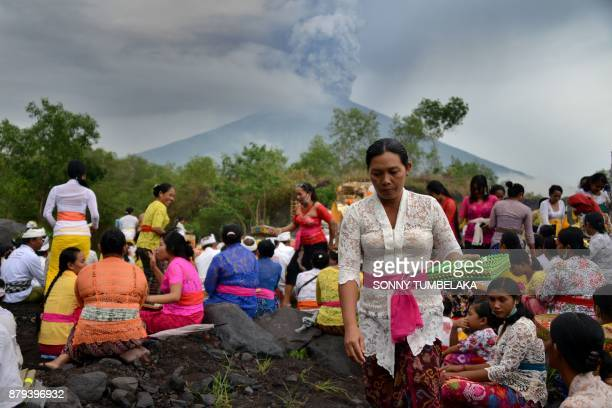 Balinese Hindus take part in a ceremony where they pray near Mount Agung in hope of preventing a volcanic eruption in Muntig village of the Kubu...