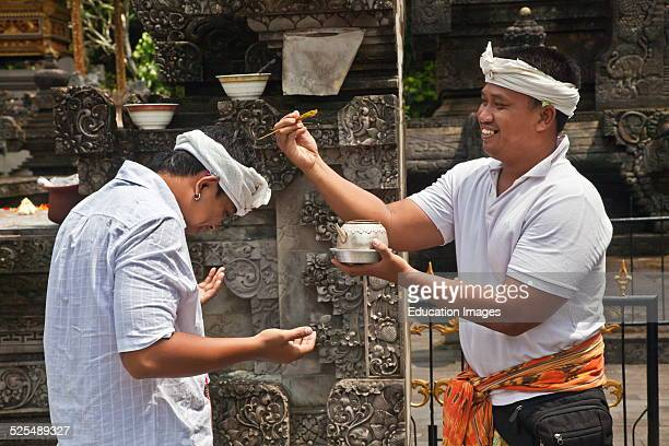 Balinese In A Purifying Ritual At Pura Tirta Empul A Hindu Temple Complex And Cold Springs With Healing Waters Tampaksiring Bali Indonesia