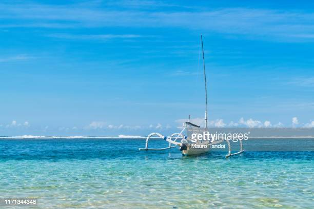 balinese jukung fishing boat - mauro tandoi stock pictures, royalty-free photos & images