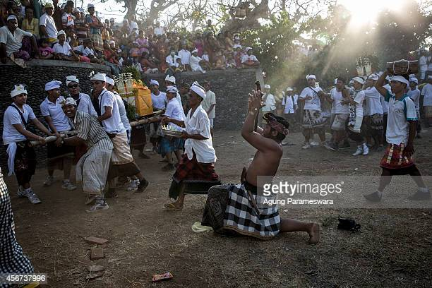 Balinese man in a state of trance stabs his chest infront of a palanquin the symbol of God during Ngusaba Gumang Ritual on October 6 2014 in...
