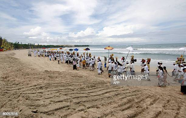 Balinese people hold the Melasti ceremony in Denpasar on March 4 2008 Melasti is a purification festival which is held a day before Nyepi On Melasti...