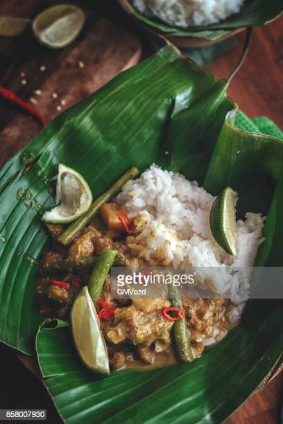 Balinese Pork Curry Dish with Jasmine Rice Served on Banana Leave
