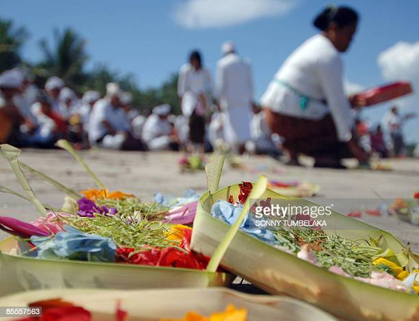Balinese pray during Melasti ceremony at Kuta beach in Bali island on March 23 2009 Melasti is a purification festival which is held three days...