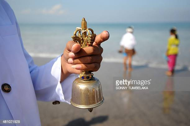 A Balinese priest prays during a Melasti ceremony prayer session at Petitenget beach in Kuta on Indonesia's resort island of Bali on March 28 2014...