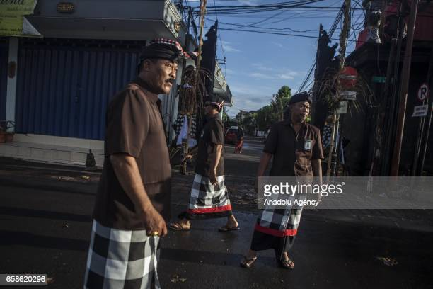 Balinese security forces Pecalang patrols are seen during the observation of Nyepi in Bali Indonesia on March 28 2017 Nyepi Day is a day of silence...