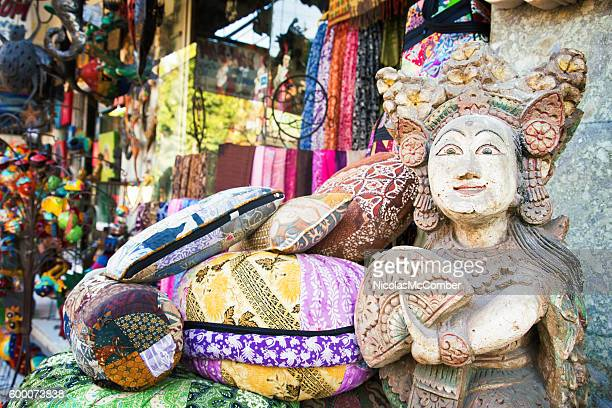 balinese statue at the entrance of ubud street market - balinese culture stock pictures, royalty-free photos & images