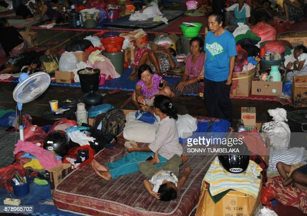 Balinese stay the night at an evacuation centre after Mt Agung volcano erupted for a second time within a week at the Klungkung Regency on...