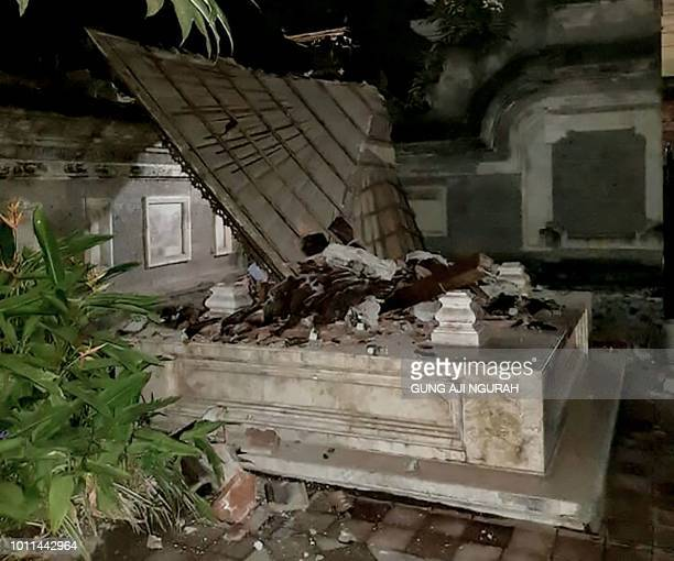 A Balinese temple is seen partially collapsed in Badung in Bali island on August 5 2018 after a major earthquake rocked neighbouring Lombok island A...