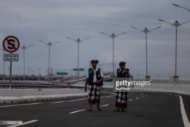 Balinese traditional guards or pecalang patrol a highway during the observation of Nyepi on March 7 2019 in Kuta Bali Indonesia Nyepi or silence day...