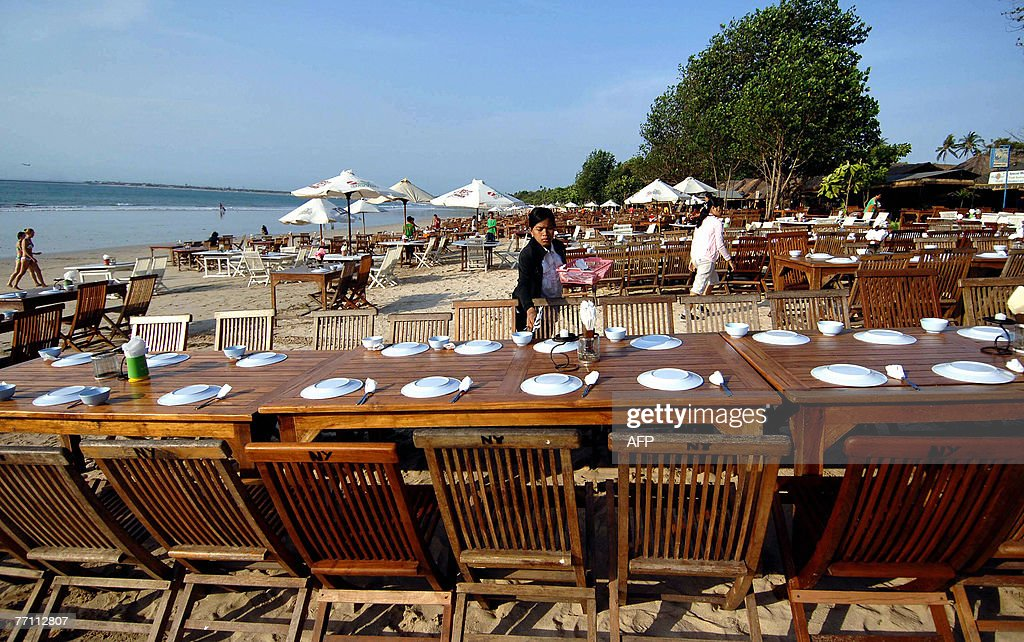 A balinese waitress c prepares tables pictures getty images