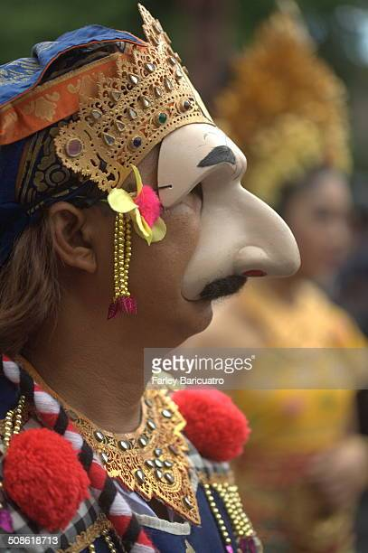 A Balinese wears a giant nose mask in the 2013 Bali Arts Festivalhe Bali Arts Festival is a full month of daily performances handicraft exhibitions...