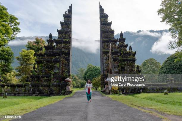 Balinese Woman in Traditional Attire at Bali Gate