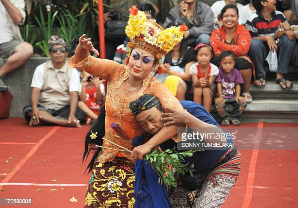 A Balinese woman performs a traditional dance of Joget Bumbung during the 35th Bali Art Festival in Denpasar on Indonesia's resort island of Bali on...