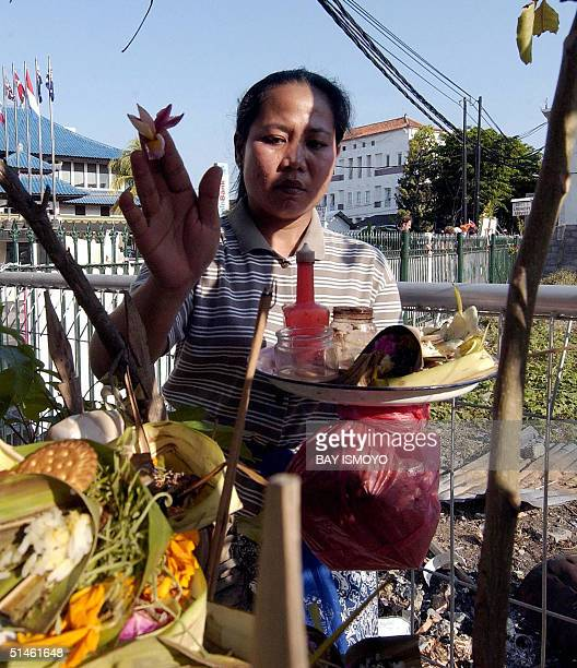 Balinese woman prays near the ground zero of the October 12 2002 bombings in Kuta Bali 11 October 2004 Indonesia on Tuesday marks two years since the...