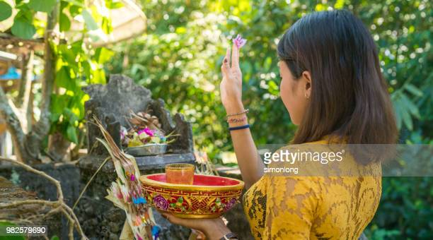 Balinese Woman worshipping in temple