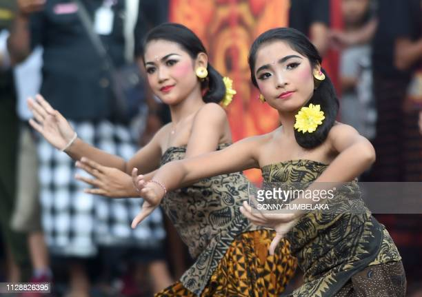 Balinese women perform during the OgohOgoh effigy parade ahead of the Day of Silence in Denpasar on Indonesia's resort island of Bali on March 6 2019...