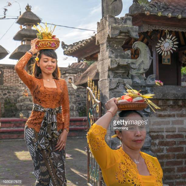 balinese women with traditional cloth - denpasar stock pictures, royalty-free photos & images
