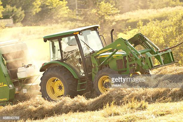 baling hay - john deere stock pictures, royalty-free photos & images