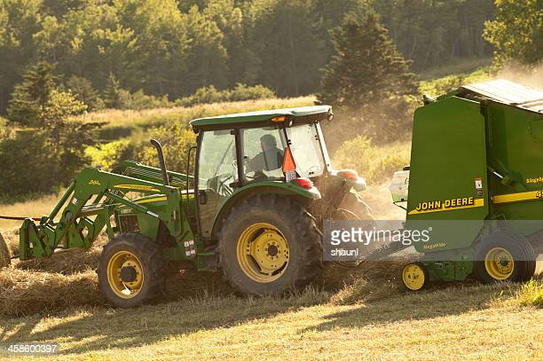 baling hay - john deere tractor stock photos and pictures