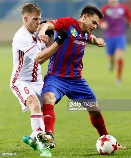 Balint Gaal of Vasas FC covers the ball from Balazs Benyei of DVSC during the Hungarian OTP Bank Liga match between Vasas FC and DVSC at Ferenc...