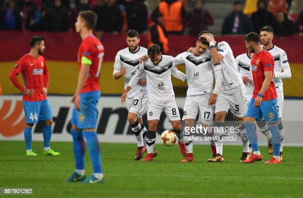 Balint Vecsei of Energy Investment Lugano celebrates with teammates after he scored the 02 against Steaua Bucharest during the UEFA Europa League...