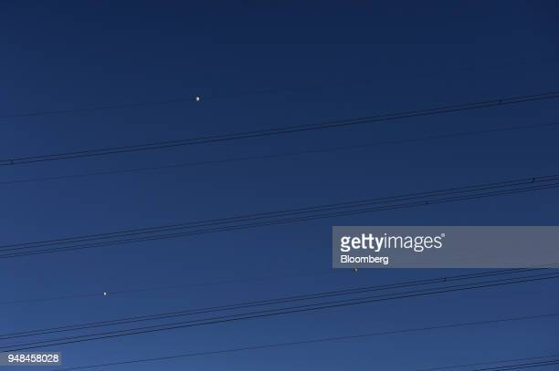 Balisor beacons hang on power lines on Torrens Island South Australia on Monday April 2 2018 A plan byTesla Incto build the world's largest virtual...