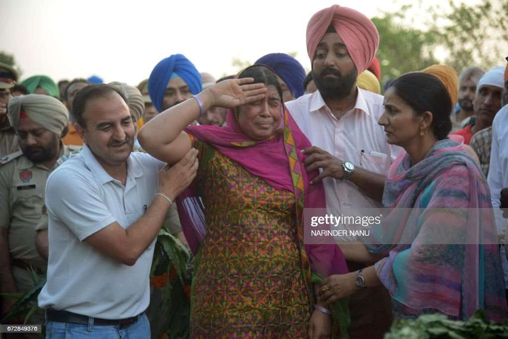 Baljit Kaur salutes after laying a wreath on the pyre of her husband Indian Central Reserve Police Force personnel Raghbir Singh at his funeral in...