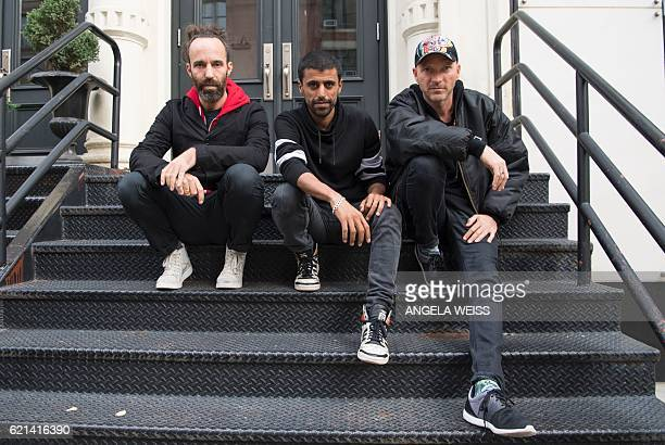 Balkan Beat Box pose for a photo after an interview with AFP in New York on October 26 2016 Infusing rap and the klezmer dance tunes of Eastern...