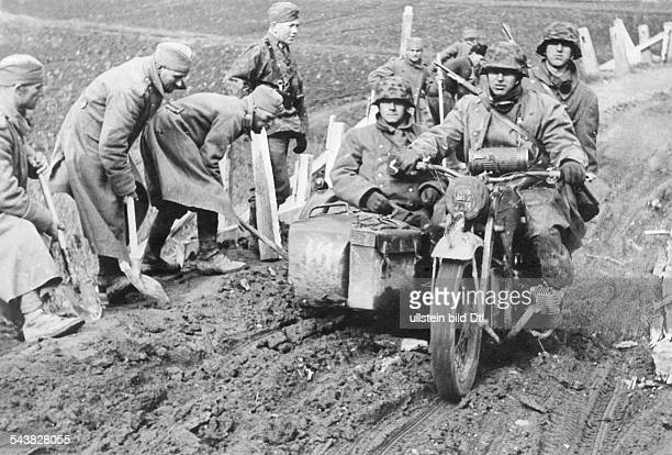 Balkans campaign 'Operation Marita' from 06.April 1941 on. / Theatre of war: Motorcyclist of the SS-Div 'Das Reich' on a supply route. Serbian...
