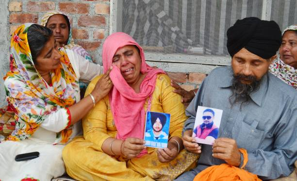 Balkar Singh and his wife Ranjit Kaur grieving the death of her son Jatinder Singh who was killed in Iraq at Silaka Village on March 20 2018 near...