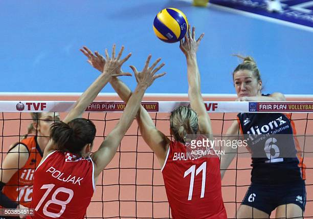 Balkestein Grothue of The Netherlands jumps for the ball with Maca Poljak and K Barun Susnjar of Croata during the European Olympic Qualification...