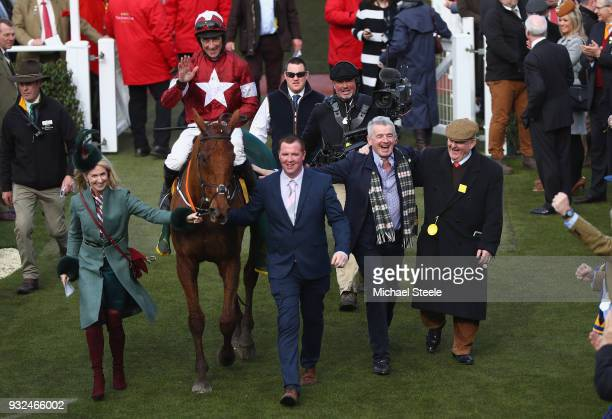 Balko Des Flos ridden by Davy Russell is lead in the the winners enclosure alongside owner Michael O'Leary 2R and Anita O'Leary after victory in the...