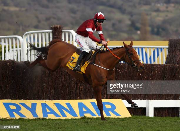 Balko Des Flos ridden by Davy Russell jumps the last on their way to victory in the Ryanair Chase at Cheltenham Racecourse on March 15 2018 in...