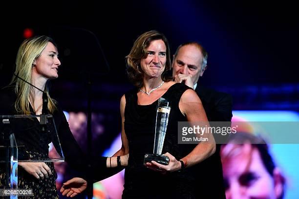 Ball Ambassador Sir Steve Redgrave and Sarah Gosling present the Olympians' Olympian Award to winner Katherine Grainger at the Team GB Ball at...