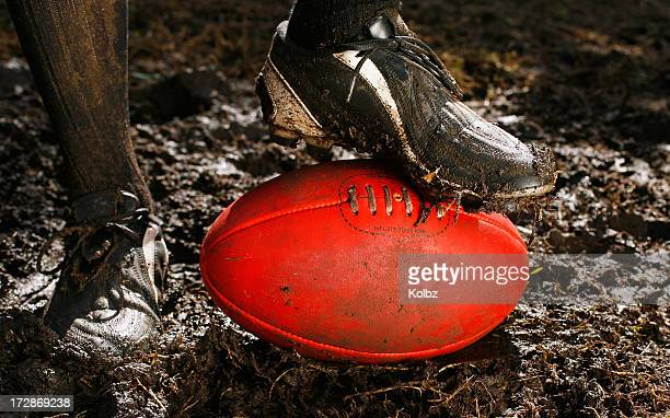 AFL Ball and Boot in Mud
