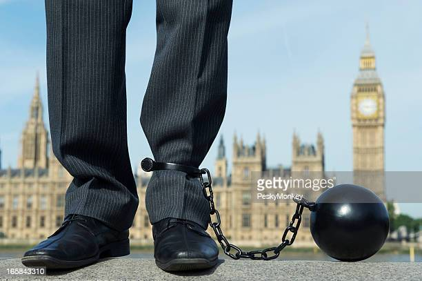 Ball and Chain Politician Stands at Houses of Parliament