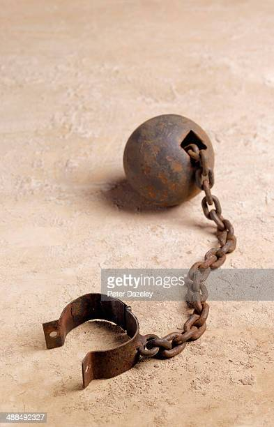 ball and chain upright - slaves in chains stock pictures, royalty-free photos & images