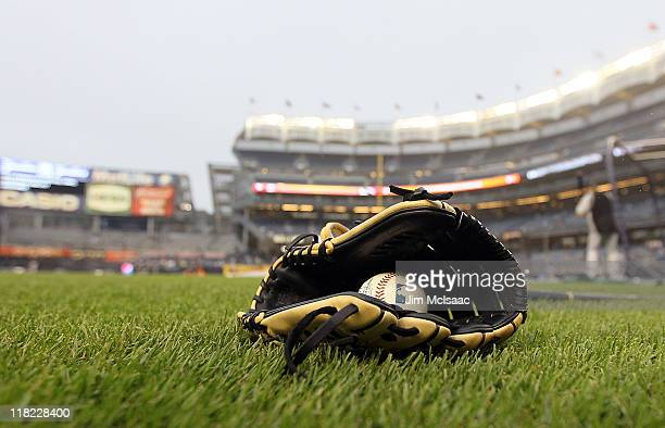 A ball and glove is seen prior to the game between the New York Yankees and the Colorado Rockies on June 24 2011 at Yankee Stadium in the Bronx...
