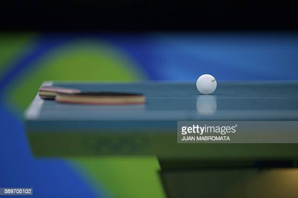 A ball and racket are pictured on the table in the women's team semifinal table tennis match between China and Singapore at the Riocentro venue...
