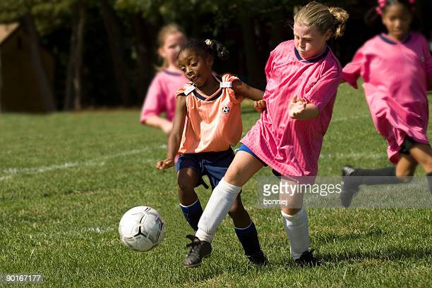 ball battle - playing football stock pictures, royalty-free photos & images