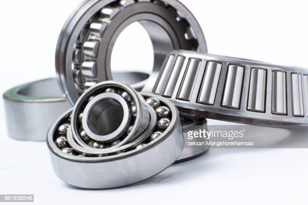 ball bearings , spherical bearings , tapered roller bearing and cylindrical bearings on isolated background - metallic belt stock pictures, royalty-free photos & images