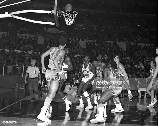 Ball bounces around rim and New York Knicks Dave Stallworth Willis Reed Dave DeBusschere and Mike Riordan and Atlantia Hawks Lou Hudson Bill Bridges...