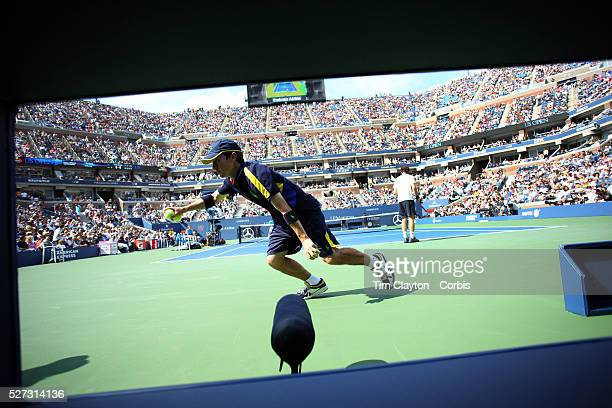 Ball boy collects a ball during the Andy Murray, Great Britain, victory during his Men's Semi-Final against Tomas Berdych, Czech Republic, during the...