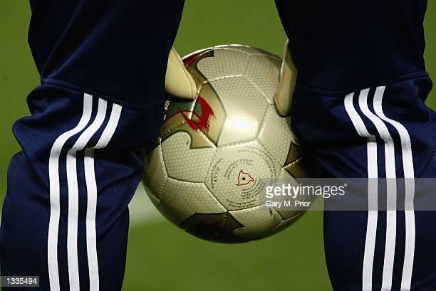 A ball boy collects a match football during the Germany v Brazil World Cup Final match played at the International Stadium Yokohama in Yokohama Japan...